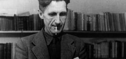 george-orwell-at-his-typewriter-e1553767392841-1600x853-1-900x425