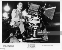 director-luis-bunuel-sitting-with-camera-on-the-set-of-the-film-le-picture-id133300062